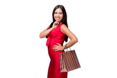 The woman in red dres after shopping isolated on white Stock Photo