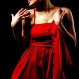 Woman in red dress. In the dark Stock Image