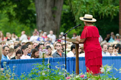 Woman with red dress. And straw hat speaking to 76 new American citizens at Independence Day Naturalization Ceremony on July 4, 2005 at Thomas Jefferson's home Stock Photo