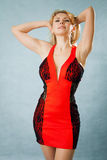 Woman in red dress. On blue background Stock Photography