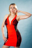 Woman in red dress. On blue background Royalty Free Stock Photography
