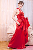 Woman in a red dress Stock Images