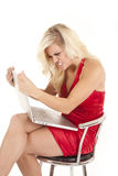 Woman red dress angry with computer Stock Photography