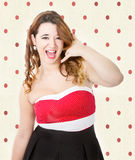 Woman in red dress answering phone Stock Photography