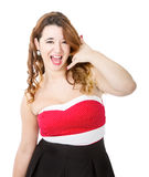 Woman in red dress answering phone Stock Photos