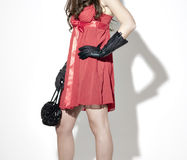 Woman in red dress back gloves and handbag Stock Images