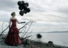 Woman red dress and balloons Stock Photography