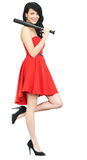 Woman in red dress with baseball bat Stock Photos