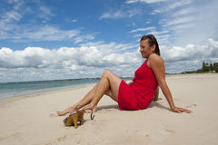 Woman in Red Dress on the Beach Royalty Free Stock Photography