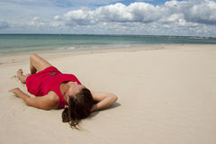 Woman in Red Dress on the Beach Stock Photo