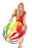 Woman red dress beach ball hold in front stock images
