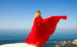 Woman in red. Woman in the red dress at the beach in Cyprus Royalty Free Stock Photos