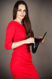Woman in a red dress Stock Photography