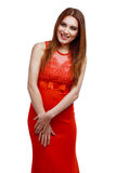 Woman with red dress. Beautiful happy young  woman,wearing a long red dress,  isolated against white background Stock Image