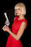 Woman red dress on black gun side serious Stock Image