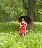 Woman in red dress with black umbrella Royalty Free Stock Images