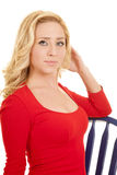 Woman red dress on blue chair close hand hair Stock Photo