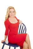 Woman red dress on blue chair look big eyes Stock Image