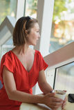 Woman in a red dress at cafe Royalty Free Stock Photo
