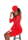Woman in red dress and cap. Royalty Free Stock Photos