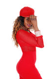 Woman in red dress and cap. Royalty Free Stock Image