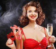 Woman in red dress at the carnival with mask Royalty Free Stock Images