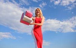 Woman red dress carries bunch shopping bags blue sky background. Finally bought favorite brands. Girl satisfied with. Shopping. Tips shop summer sales stock image