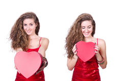 The woman in red dress with christmas gifts Royalty Free Stock Photo
