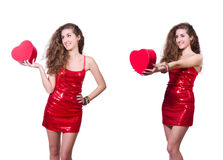The woman in red dress with christmas gifts Stock Image