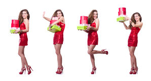 The woman in red dress with christmas gifts Stock Photography