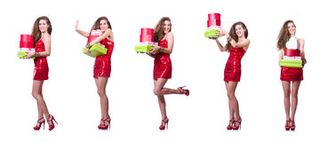 The woman in red dress with christmas gifts Royalty Free Stock Photography