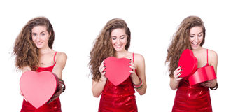 The woman in red dress with christmas gifts Royalty Free Stock Photos