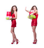 The woman in red dress with christmas gifts Royalty Free Stock Images