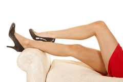 Woman red dress close legs black heels Royalty Free Stock Photography