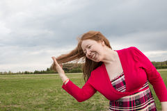 Woman in red dress and cloud sky Royalty Free Stock Images