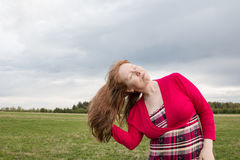 Woman in red dress and cloud sky Royalty Free Stock Photo
