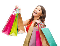 Woman in red dress with colorful shopping bags Stock Image