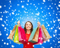 Woman in red dress with colorful shopping bags Royalty Free Stock Image