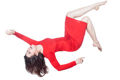 Woman in red dress falls. Woman in red dress floating in the air falling on a white background Royalty Free Stock Image