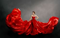 Woman Red Dress, Fashion Model in Long Silk Gown Waving Cloth on Wind, Flying Fabric. Woman Red Dress, Fashion Model in Long Silk Gown Waving Cloth on Wind royalty free stock image