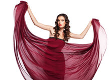 Woman in red dress flying on wind isolated Royalty Free Stock Image