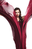 Woman in red dress flying on wind isolated Stock Photo