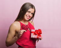 Woman in red dress with a gift box Royalty Free Stock Images