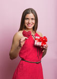 Woman in red dress with a gift box Stock Image