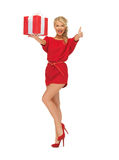 Woman in red dress with gift box Royalty Free Stock Images