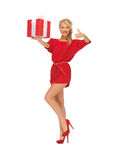 Woman in red dress with gift box Royalty Free Stock Photography