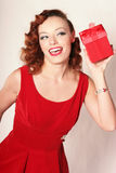 Woman in Red Dress with Gift Box Stock Photos