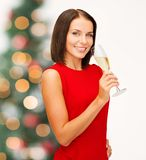 Woman in red dress with a glass of champagne Stock Images