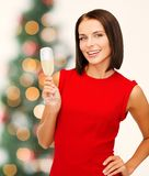 Woman in red dress with a glass of champagne Royalty Free Stock Photo