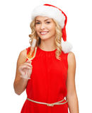 Woman in red dress with a glass of champagne Royalty Free Stock Image